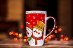 Christmas tea cup on a bokeh background. Red christmas tea cup on a bokeh background stock photos