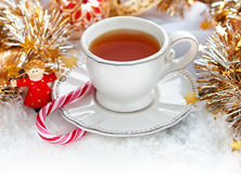 Christmas tea cup. Christmas cup of tea with Christmas decor Stock Photos