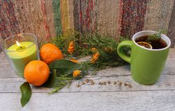 Christmas Tea with dried lemons, candle, mandarins and arborvitae Stock Images