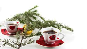 Christmas tea-drinking. (two cups and fir branch Royalty Free Stock Photo