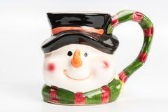 Christmas tea mug with snowman on white Royalty Free Stock Photo