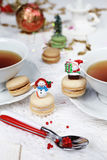 Christmas tea party with macaroons, sweet meringue-based Royalty Free Stock Photography