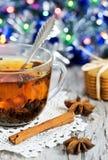 Christmas tea and shiny garland Stock Photo