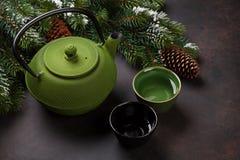 Christmas tea. Pot and tea cups Royalty Free Stock Photos