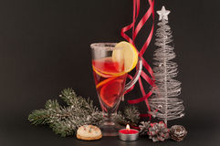 Christmas tea. Christmas tree, candles, lights, cones, lemons, red ribbons on black background royalty free stock photo