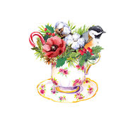 Christmas teacup - bird, fir tree, mistletoe. Tea time watercolor. Christmas tea cup - bird, fir tree, mistletoe, cotton and new year candy cane. Vintage Stock Photo