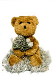 Christmas Ted. A brown bear holding a christmas decoration sat in tinsel stock photo