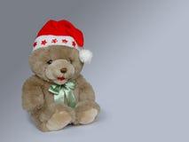 Christmas teddy. On grey background Royalty Free Stock Image