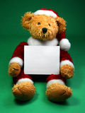 Christmas Teddy Bear. Stuffed Christmas toy animal Santa holding card Stock Images