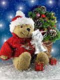 Christmas teddy bear. Teddy bear with bell and christmas tree Stock Photography