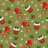 Christmas teddy bear, gift box and candy green seamless wallpape Stock Image