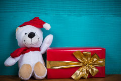 Christmas teddy bear and gift Royalty Free Stock Images