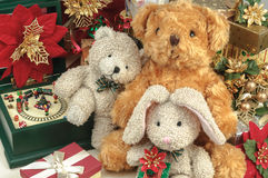 Christmas teddy bear with gifts and friends Stock Photos