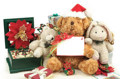 Christmas teddy bear with gifts and friends Royalty Free Stock Images