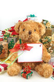 Christmas teddy bear with gifts and white space card Stock Photo