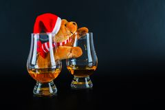 Christmas teddy bear with glass of single malt whiskey, symbol o. F Christmas holiday, Xmas set, decoration Royalty Free Stock Photography