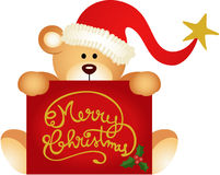 Christmas teddy bear holding a Merry Christmas Royalty Free Stock Images