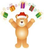 Christmas teddy bear juggling gifts Royalty Free Stock Photo