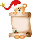 Christmas teddy bear with parchment Royalty Free Stock Image