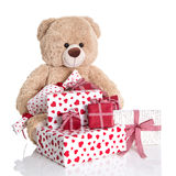 Christmas: Teddy bear with pile of red and white birthday or val Royalty Free Stock Images