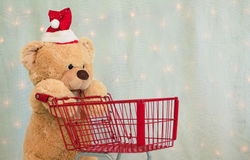 Christmas teddy bear pushing shopping cart Stock Photo