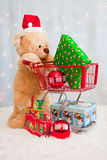Christmas teddy bear pushing shopping cart Stock Image