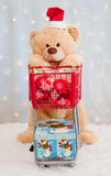 Christmas teddy bear pushing shopping cart Stock Photos