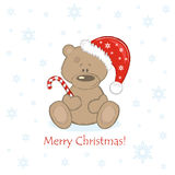 Christmas Teddy Bear in the red bell with sweet Royalty Free Stock Photography