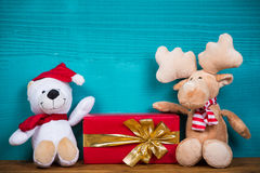 Christmas teddy bear and reindeer Stock Images