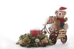 Christmas Teddy Bear on a Rickshaw. Royalty Free Stock Image
