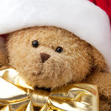 Christmas teddy bear in Santa cap Stock Image