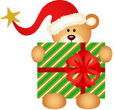 Christmas teddy bear with santa claus hat Stock Image