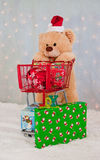 Christmas teddy bear and shopping cart Royalty Free Stock Photo