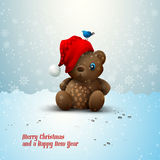 Christmas Teddy Bear Sitting Alone in the Snow Royalty Free Stock Photography