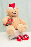 Christmas teddy bear sitting on chair Royalty Free Stock Image