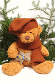 Christmas teddy-bear with a toy Royalty Free Stock Photo