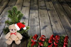 Christmas teddy bear on wooden background Royalty Free Stock Photography