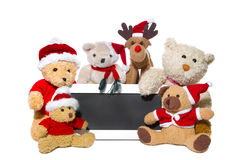 Christmas teddy bears, elk and message board on white background Royalty Free Stock Photography