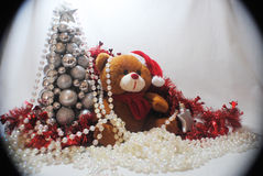 Christmas teddy 4. Christmas teddy with a silver star amongst red tinsel, white beads and a silver tree Royalty Free Stock Images