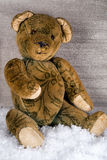 Christmas Teddy sitting lonely in the snow Royalty Free Stock Photography