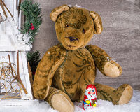Christmas Teddy sitting in the snow with Santa Claus Royalty Free Stock Photo