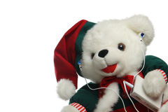 Christmas teddybear with mp3 player Royalty Free Stock Photo