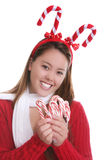 Christmas teen and candy canes Royalty Free Stock Photos