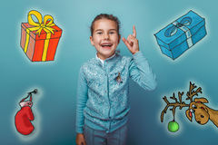 Christmas teen girl raised her thumbs up from Royalty Free Stock Images