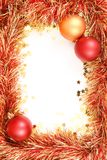 Christmas template. With white space surrounded by Christmas decorations, tinsel and confetti royalty free stock photo