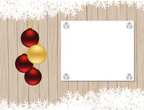Christmas template. Christmas balls and a piece of paper on wooden background. Vector illustration Royalty Free Stock Image