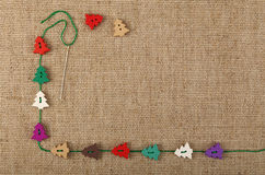 Christmas template of craft buttons over canvas Stock Photo