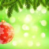 Christmas template with hanging red ball and fir. Christmas vector template with hanging red ball and fir tree branches on green bokeh light background Royalty Free Illustration