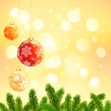 Christmas template with hanging red balls and fir. Christmas vector template with hanging red balls and fir tree branches on yellow bokeh background Stock Photo