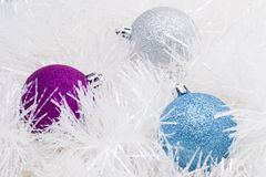 Christmas template. Three  coloful christmas ball with  fluffy tinsel Stock Photography